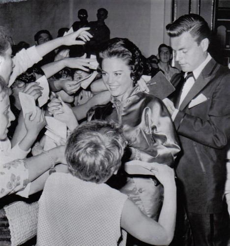Natalie and Robert sign the autographs