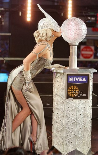 Lady Gaga pushing the countdown button on NYE