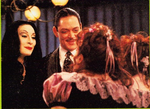 Raul Julia as Gomez