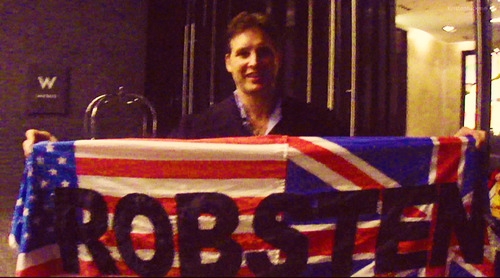 "Peter Facinelli holding a ""Robsten"" Flag"