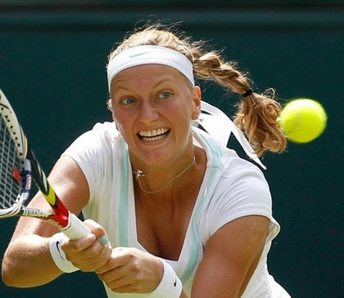 Petra Kvitova has same color nail polish as a hem dress