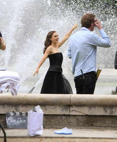 Modeling for a Miss Dior campaign ছবি shoot in the gardens of the Palais-Royal in Paris (June 26t