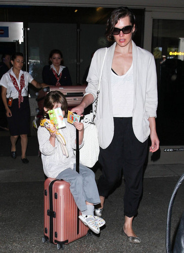 Milla Jovovich And Ever Land In LA [July 10, 2012]