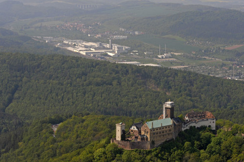 eisenach wartburg castle with opel-factory in background