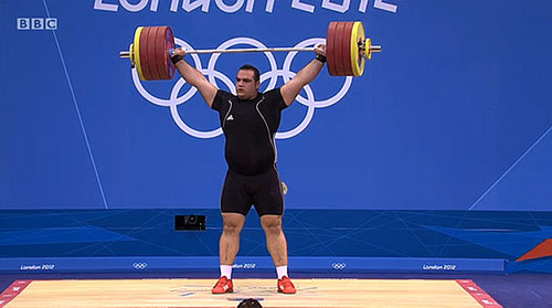 Behdad Salimi Leads Iran Gold-Silver in Weightlifting