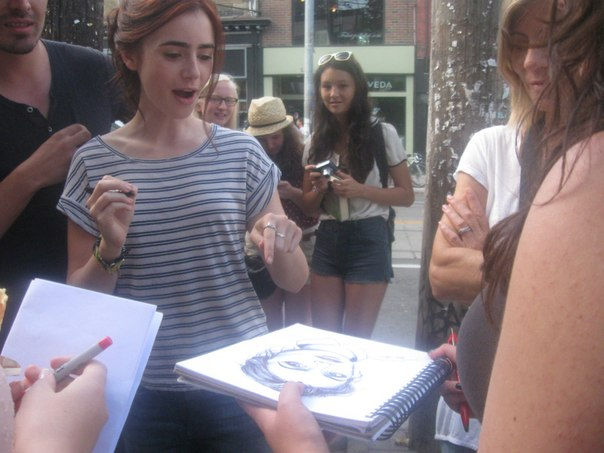 Lily signing autographs on the set of city of bones